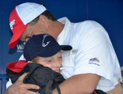Co-angler Terry Stevens of Sterling, Va., embraces his son shortly after winning the EverStart Potomac River title.