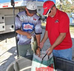 After resuming the pro division lead, Robbie Dodson puts his fish back into a bag of water and Rejuvenade.