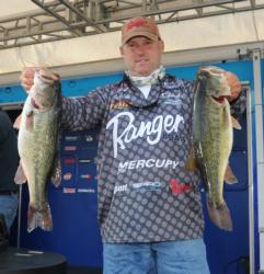 Third-place pro Robert Behrle holds up a pair of 5-pound largmouths.