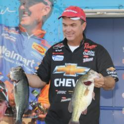 Jay Yelas shows off his 21-8 catch that put him in fifth place on day three.