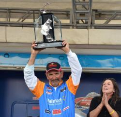 Veteran pro Paul Elias holds up his trophy for winning the FLW Tour event on Lake Guntersville.