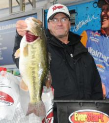 Beecher Strunk of Somerset, Ky., shows off a 9-pound, 6-ounce monster that earned him the co-angler lead and big bass honors on day one.