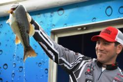 Pro Zack Thompson of Alameda, Calif., shows off his second-place catch at the EverStart Lake Shasta event.