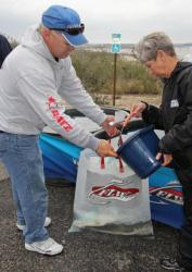 Day-one leader Trent Huckaby gets some water on his tournament leading fish.