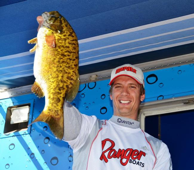 Pro Troy Lindner of Los Angeles, Calif., holds up his first place catch during final EverStart weigh-in on Lake Havasu.