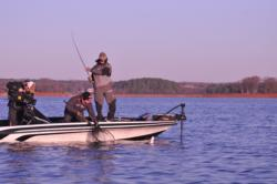 Brent Ehrler hauls in his catch en route to a first-place finish during the 2012 FLW Tour event on Lake Hartwell.