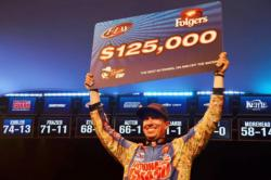 Brent Ehrler of Redlands, Calif., shows off his first-place check after winning the FLW Tour event on Lake Hartwell.