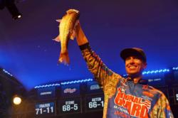 Brent Ehrler of Redlands, Calif., holds up part of his winning catch at the FLW Tour Lake Hartwell event.