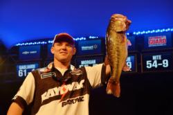 Micah Frazier of Newnan, Ga., proudly displays his second-place catch during the finals of the FLW Tour Lake Hartwell event.