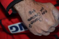 Marty Stone reveals his hand-inscribed tournament dedication to a friend who recently lost his life in a house fire.