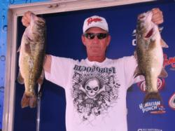 Douglas Tull of Felicity, Ohio, leads the Co-angler Division of the EverStart Series event on Lake Seminole with a five bass limit for 18 pounds.