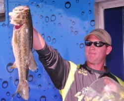 Brandon McMillan holds up the winning fish.