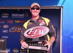 Brandon McMillan with the winning hardware.