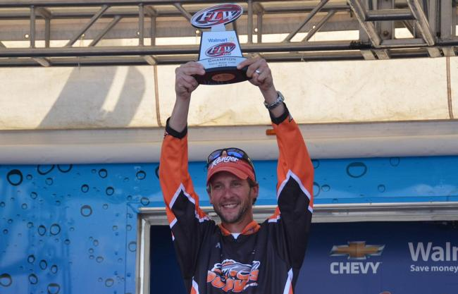 Co-angler Patrick Bone holds up his trophy for winning the FLW Tour event on Table Rock Lake.
