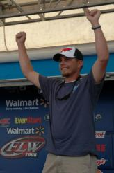 Tyler Webb of Arnett, W. Va., raises his hands in the air in victory shortly after winning the Co-angler Division at the 2012 TBF National Championship at Bull Shoals Lake.