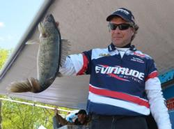 Fifth-place pro Joe Whitten holds up his biggest walleye from day two on the Mississippi River.