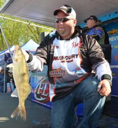 Fourth-place pro Brian Bjorkman holds up a chunky Mississippi River walleye.