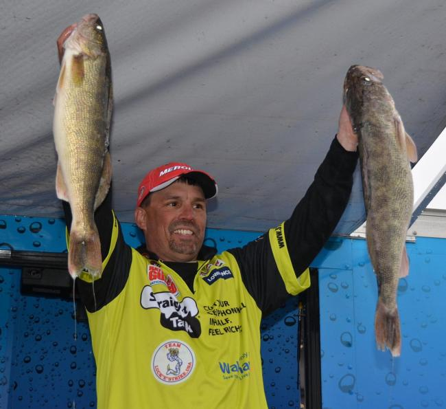 Third-place pro Brett King holds up two nice Mississippi River walleyes.
