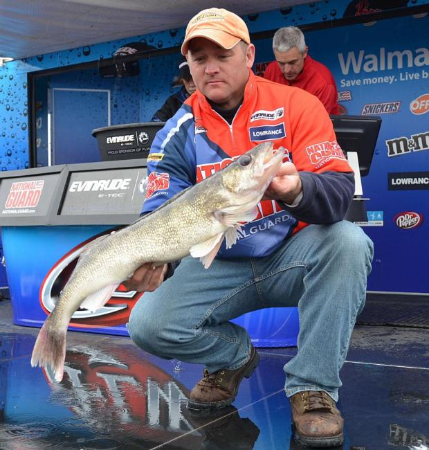 Fifth-place pro Robert Bruegger holds up his largest walleye from day three on the Mississippi River.