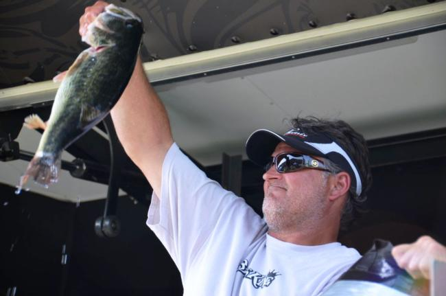 Pro Jay Wright of Seal Beach, Calif., holds up his first-place catch during the  EverStart Clear Lake event.