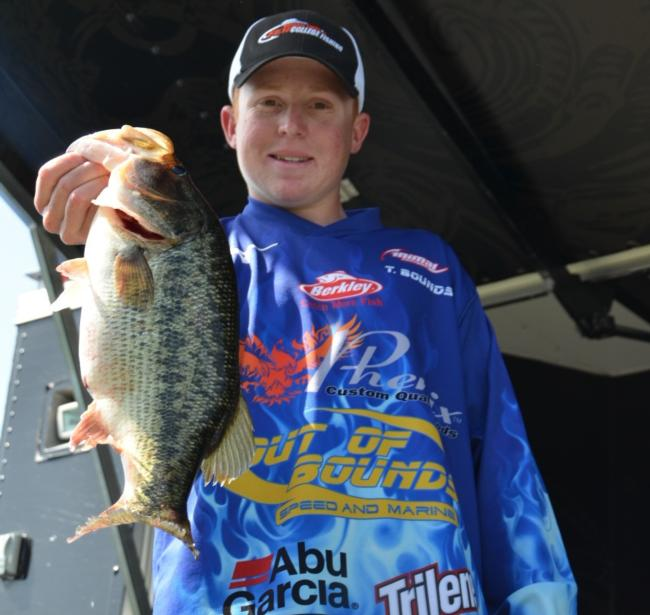 Co-angler Travis Bounds of Roseville, Calif., shows off part of his first-place catch on Clear Lake.