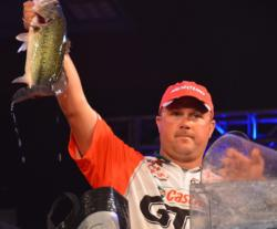 Pro winner David Dudley holds up a kicker largemouth from day four on Beaver Lake.