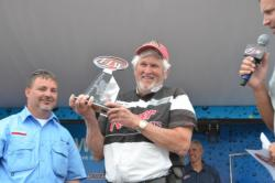 Co-angler Jimmy Cox of Bono, Ark., took home the title from the National Guard FLW Walleye Tour event on Lake Erie with a three-day total catch of 115 pounds, 12 ounces.
