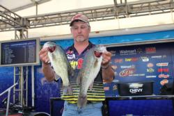 Second-place boater Dick Shaffer caught his fish on wood and boat docks.