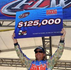 National Guard pro Scott Martin of Clewiston, Fla., proudly displays his first-place check after capturing the FLW Tour title on the Potomac River.