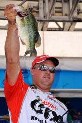 Castrol pro David Dudley of Lynchburg, Va., holds up his third-place catch during the FLW Tour finals on the Potomac River.