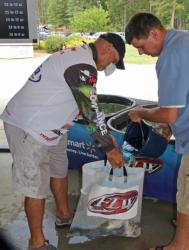 Tim Reneau gets a bucket of fresh water on his fish after taking the day-one lead.