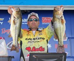 Fourth-place David Harvey ducked into a creek arm when the storm passed through and continued catching fish.