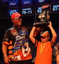 Dave Lefebre gives his son, Mitchell, a chance to hoist the winner
