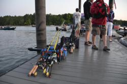 Co-anglers patiently wait with tackle ready to go.