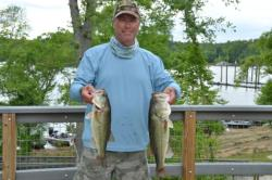 Ron Wolfarth of Oakboro, N.C., shows his catch from his 14 pound, 6 ounce bag.