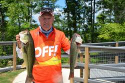 Off! pro Nick Gainey shows two nice fish from his 12-pound, 15-ounce bag on day two.