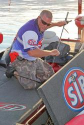 Fourth-place pro Joe Thompson loads his rods in preparation for the final round of Lake Champlain competition.