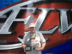 Co-angler Robert Huffine of Maryville, Tenn., won the June 30 Bama Division event on Neely Henry with four bass that weighed 15 pounds, 1 ounce. Huffine took home a check worth close to $1,800 for his win.