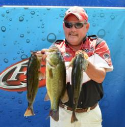 Fifth-place pro Kevin Johnson holds up his three-fish limit Friday.