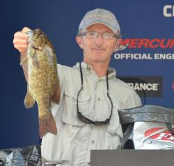 Third-place co-angler Richard Conrad holds up a nice Mississippi River smallmouth.