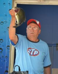 Second-place co-angler Randy Warner holds up his biggest bass from day three on the Mississippi River.