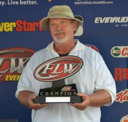 Co-angler champion Rex McTier holds up his trophy for winning the third EverStart Series Central Division qualifier.