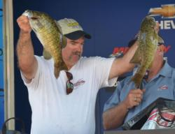 Fourth-place pro Dan Thill shows off an impressive pair of smallmouths.