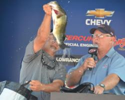 Pro champion Paul Malone holds up a fiesty Mississippi River largemouth.