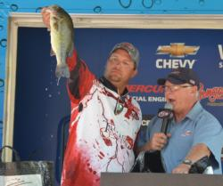 Second-place finisher Zach King holds up his biggest bass from the final day.