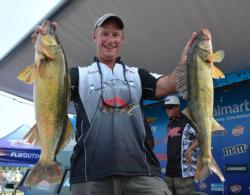 Akaska, S.D., pro Chad Schilling shows off two nice fish from his 21-pound, 8-ounce limit on day two.