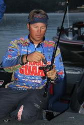 Defending Forrest Wood Cup champion Scott Martin rigs up a jigging spoon prior to takeoff.