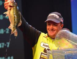 Second-place finisher Scott Canterbury holds up his biggest bass from day four on Lake Lanier.
