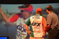 Castrol pro David Dudley watches on-the-water video of himself onstage during weigh-in. Dudley finished the 2012 Forrest Wood Cup in fifth place.