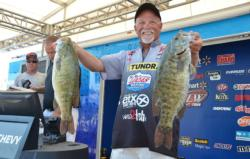 Pro leader Bill McDonald smiles as he shows off part of his 25-pound, 2-ounce stringer.